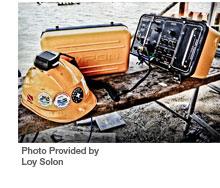 The rugged Amcom II portable diving radio on the job site. - Photo Provided by Loy Solon
